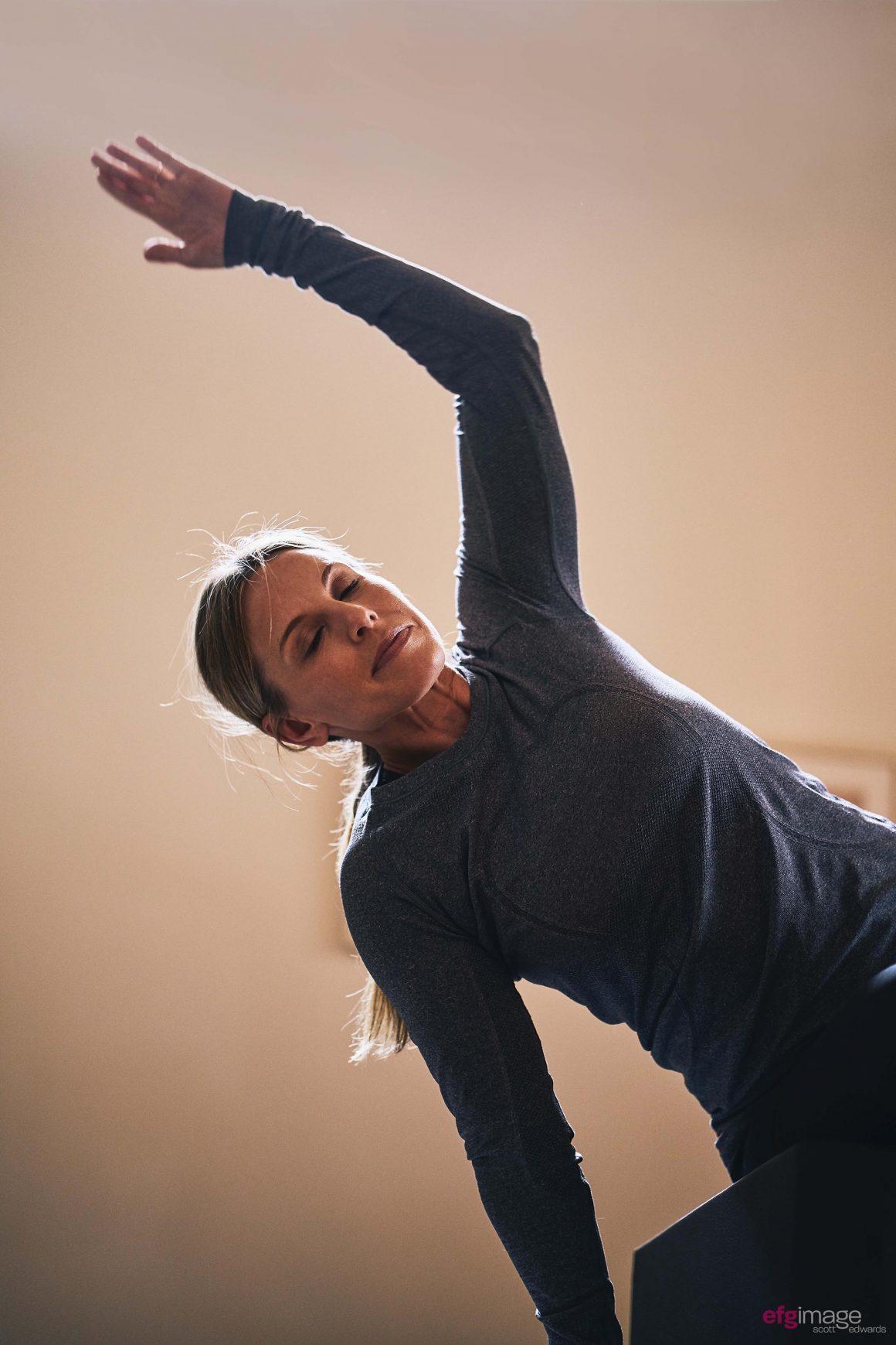 beautiful girl does pilates exercise