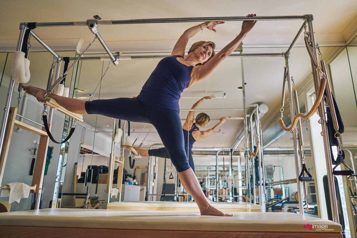 Beautiful woman does pilates exercise