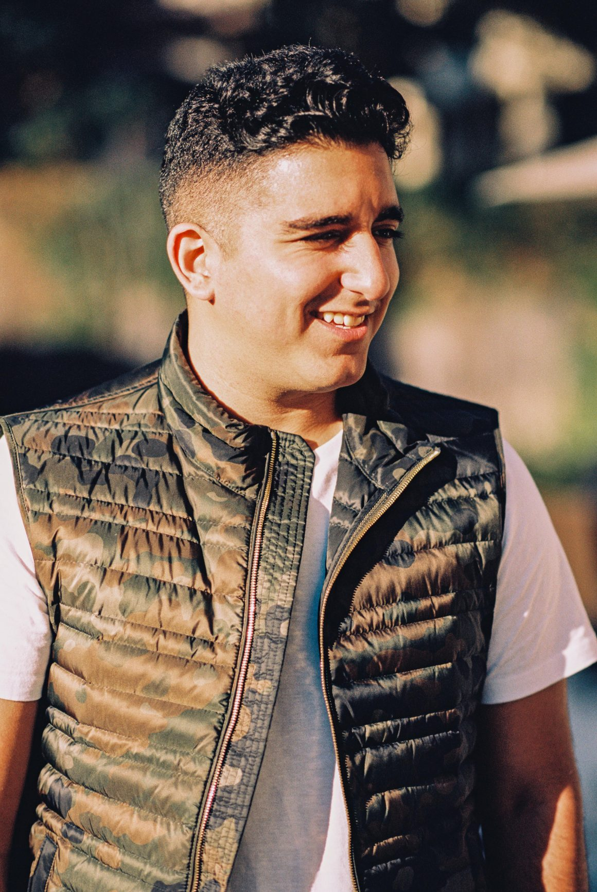 Young man with camouflage Burberry vest