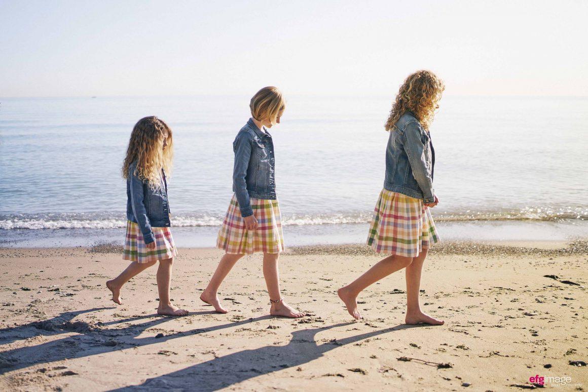 girls walk in a row